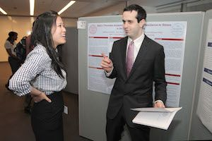 Second-year students Angela Jia and Matthew Schelke chat between sessions at Medical Student Research Day.